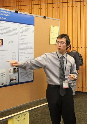 Honor student presenting poster