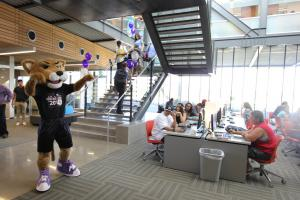 """""""Roary"""" greets students in Estrella Hall Computer Commons"""