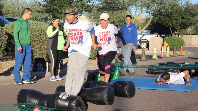 2015 Fun Run participants at a boot camp station