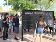 """EMCC students complete the """"When I Graduate"""" wall to declare their goals after graduation."""